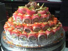 """Sushi Cake .... SERIOUSLY?!?!? emailing this to my Hub for next year! I don't want to hear he """"didn't know"""". ;)"""