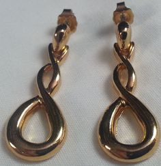 Gold tone earrings signed Avon dangle twist #Avon