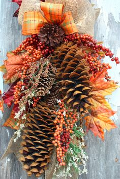 Fall Swag, Sugar Pinecones, Berries, Burlap, Plaid Ribbon.-I really like this combination of pinecones mixed with fall leaves