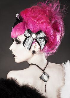 Beautiful pink hair and a slight gothic lolita feel! Love it!