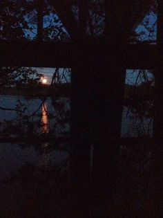 Summer night in summer cottage, moon is rising.