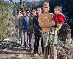 """Rajo Verma, 21, lives in a one-room shack with all five, sleeping with a   different one each night on a rota. The housewife has no idea which one  is the father of her toddler son. She said: """"Initially it felt a bit  awkward. But I don't favour one over the  other.""""  Husband Guddu, 21 - the first"""