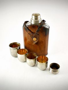 Antique Leather Flask w/sharing cups from EcoRetroStore.etsy.com
