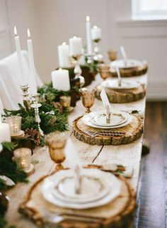 Like the idea of greens and candles and pine ones, not so rustic with those wood slice chargers