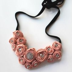 peach. could totally make this, just make some ribbon roses, put some vintage pins or buttons in the middle, glue together, sew on a ribbon or hot glue on a chain, and voila!