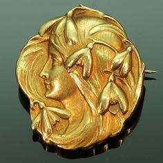 """Art Nouveau brooch womans head with snowdrops symbolizing a new beginnings"""""""