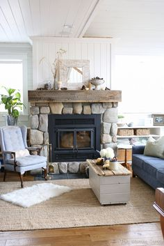 stone fireplace - reclaimed mantle - white shiplap