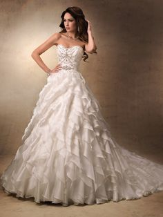 Ruffled diagonal Maggie Sottero wedding dress.. I am in LOVE with this dress!!