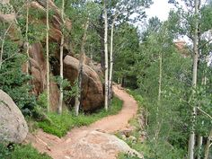 Along the Barr trail.. Barr Trail is a popular 12.6-mile (20.3 km) trail that climbs 7,800 feet (2,400 m) from Manitou Springs, Colorado, USA to the top of Pikes Peak mountain.
