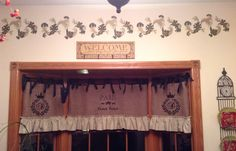 The latest completed project at The French Farmhouse -  I created new curtains in my foyer bay window from washed burlap, muslin ruffles and black grosgrain ribbon -  then I stenciled with some French stencils and hung them with tension rods -  What do you think of the result ?