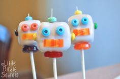 cute robot cake pops mainly using candy necklace pieces