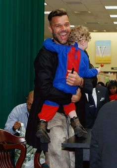 Free hugs for everyone. Ricky Martin embraces a young fan after signing his new children's book, Santiago The Dreamer In Land Among The Stars, on Nov. 12 in New York