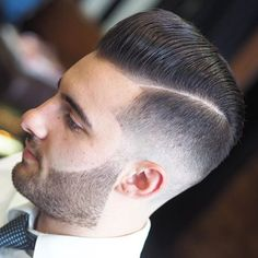 Low Skin Fade with Hard Part and Brush Back