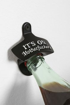 Wall-Mounted Bottle Opener... Ian would like this. Maybe with less offensive words on it tho... WOAH