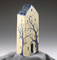 Pottery house with tree. Maybe do one this shape, plus a cross on top (i.e. make it a church)