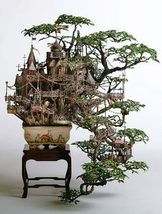 "Japanese artist Takanori Aiba used to be an architect and maze designer/illustrator. He decided to take his skills to creating these table top worlds that would fit in a Bonzai Tree vase. Using paper, plastic, plaster, resin and paint, he creates these amazing, intricate and tiny buildings around bonsai trees...""  Source: espvisuals.blogspot.com.au"