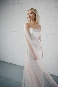If you are non veiled bride but want to add little drama in your bridal outfit, ombre bridal cape is perfect choice. The detachable soft tulle wedding cape veil has a delicate drape back and show the elegance of the back of your dress. #bridalcape #weddingcape #bridalcoverup