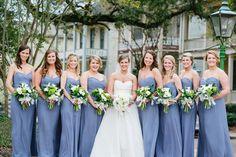 Blue-violet bridesmaids dresses.
