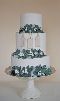 Mistletoe winter wedding Cake by Erica O'Brien