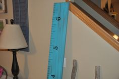 """A very fun ruler! 6 feet tall and 8"""" wide with hand painted lines and numbers.  Measurements begin at 6"""" to allow for baseboards and go to 6'6"""" unless requested otherwise. Each one is unique.  This is made to look worn as you can see the dark stain beneath the paint. If you prefer one with no blemishes or one with a lot of character, please let us know and we will do our best to get the piece of lumber that is perfect for you!"""
