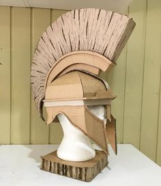 Cardboard Greek Mythology Helmet by Zygote Brown Designs Cardboard Costume, Cardboard Mask, Cardboard Sculpture, Cardboard Crafts, Paper Crafts, Recycled Dress, Recycled Art, Biblical Costumes, Greek Helmet