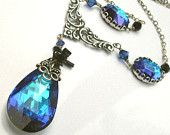 Crystal pendant necklace, Bermuda Blue. Crystal, glass jewels, filigree, black bow, wire wrapped antique silver. Blue crystal jewelry. N200v