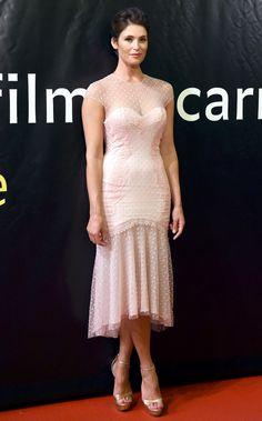 Gemma Arterton in a blush pink Swiss dot midi dress