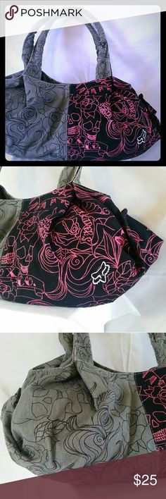"Womens Fox Racing Handbag / Purse Very cute hobo/ bucket style bag. Has skulls, roses and fox logo design. Measures 20"" long & 9"" deep. This item is cross posted. Fox Racing  Bags Hobos"