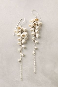 dat is het ...    Lily-Of-The-Valley Drops - anthropologie.com
