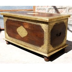 Add regal elegance and extra storage space with the Heritage Contemporary Brass Inlaid Chest. This decorative trunk is made of Solid Indian Rosewood and features inlaid brass decorative work on the top, sides and front. The storage box is colored with a dark oak stain inside and out. This classic piece can also be used as an accent table or coffee table.