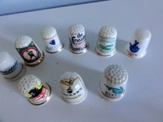 9 porcelain thimbles advertising corporate business Le Shuttle the Lottery etc