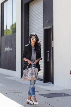 Work or play: Black blazer + gray t-shirt + distressed jeans + white block heels + snake print satchel