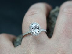 Check out this item in my Etsy shop https://www.etsy.com/listing/213201685/halo-diamond-engagement-ring-ovale