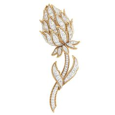 Gold, Platinum and Diamond Flower Clip-Brooch, Van Cleef & Arpels  The flower set throughout with 127 round and single-cut diamonds approximately 6.20 cts., edged by rope-twist gold