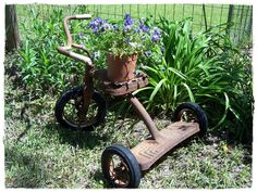 rusty old tricycle garden art. I have this tricycle in my basement ...