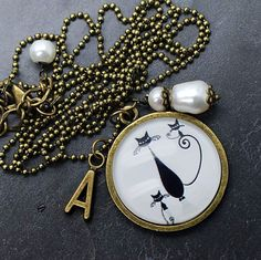 Vintage brass  ball chaine with pendants. Glass cabochon, initial charm, freshwater pearls.