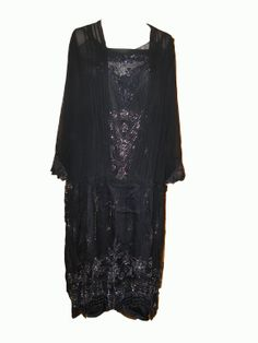 Black sheer evening dress with silver beading.