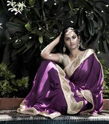A simple Georgette Saree with a wide stylish Patti of raw-silk in copper shade, electrified by Crochet flower motifs of zari threads to makes it a perfect match for the talented young lady.  Handpicked by our creative designer, this brilliant Saree is made of Georgette fabric. A lavish 4.25 inch Patti in raw-silk, with a trace of cord piping. Stunning Crochet flower motifs of zari threads of 3 inches in diameter. Option to get Celebrity attention. Shop for Bewitched Designer Crochet Blouse…