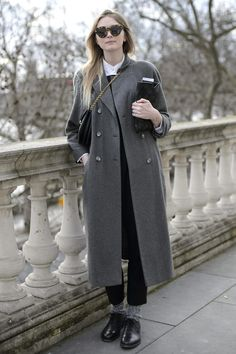 This showgoer showed off a classic coat with an updated styling trick — a purse worn crossbody style. Jane McFarland