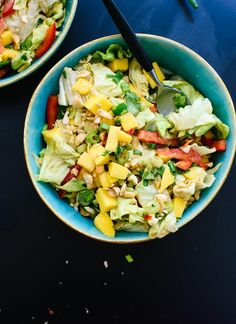 This fresh Thai salad recipe features mango, bell pepper, greens and a delicious peanut dressing! It's a little spicy, a little sweet and full of flavor.