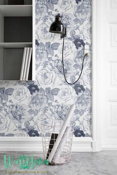 Transform any room in your home into a floral paradise with this adhesive wallpaper! This vinyl wallpaper features a soft pastel print of blue