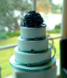 Turquoise & Paua flax cake topper and Hapene ribbon by Artiflax    Cake by Cake Couture New Zealand