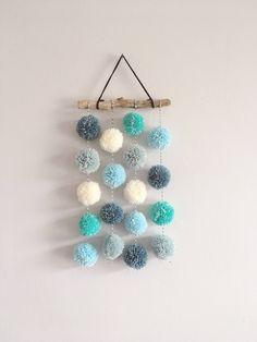 £16, choose colours. Pom Pom Hanging, Nursery Decor, Home Decor, Driftwood, Pom Poms, Wall Decor by alittlerayofcrochet on Etsy https://www.etsy.com/uk/listing/491954676/pom-pom-hanging-nursery-decor-home-decor