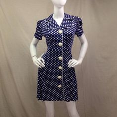 60s Vintage Navy Blue Shirtdress, Mod Button Down. Blue and White polkadots, thigh length dress with puffy short sleeves. Rockabilly pinup or British invasion. Either way, great spring or summer dress.