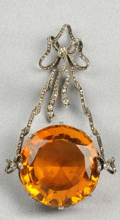 Antique Citrine and Diamond Pendant, the large circular-cut citrine measuring approx. 27.00 x 15.50 mm, suspended from a silver and rose-cut diamond ribbon, lg. 2 5/8 in.