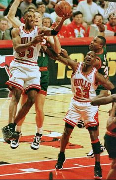 Scottie Pippen gets baseline past Detlef Schrempf for a layup as teammate Michael Jordan blocks out as many Sonics players as he can during the 96 Finals in Chicago.