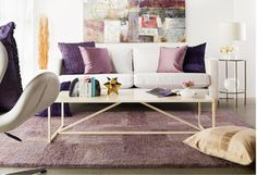 Taking your living room to the A-List? Let tones do the talking. Cream upholstery sets a sophisticated ambience, while limited gold accents offer just enough luxe. Forget the red carpet: Opt for a fresh take on royal purple and show off a lilac rug or lavender throw that gives your glam space a palace-like glow.http://www.allmodern.com/deals-and-design-ideas/Glam-Living-Room~E20613.html?refid=SBP.rBAZEVUE0NaYIBV9d2B_AldM4sIdCkCIp1uwOCNlPxk