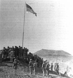 American soldiers saluting the American Flag - Battle of Iwo Jima