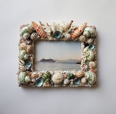 Custom seashell and coral frame. Seashell Chandelier, Fireplace Surrounds, Sea Shells, Kendall, Coral, Frame, Interior, Home Decor, Picture Frame