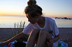 sitting at  beach